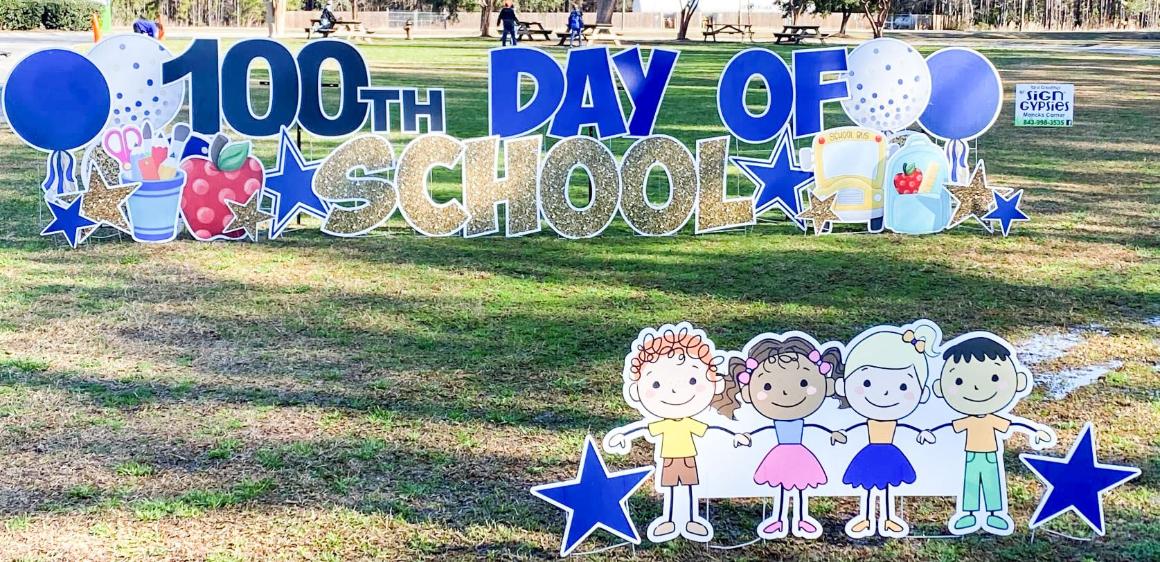 "sign that reads ""100th day of school"" in front of bES"