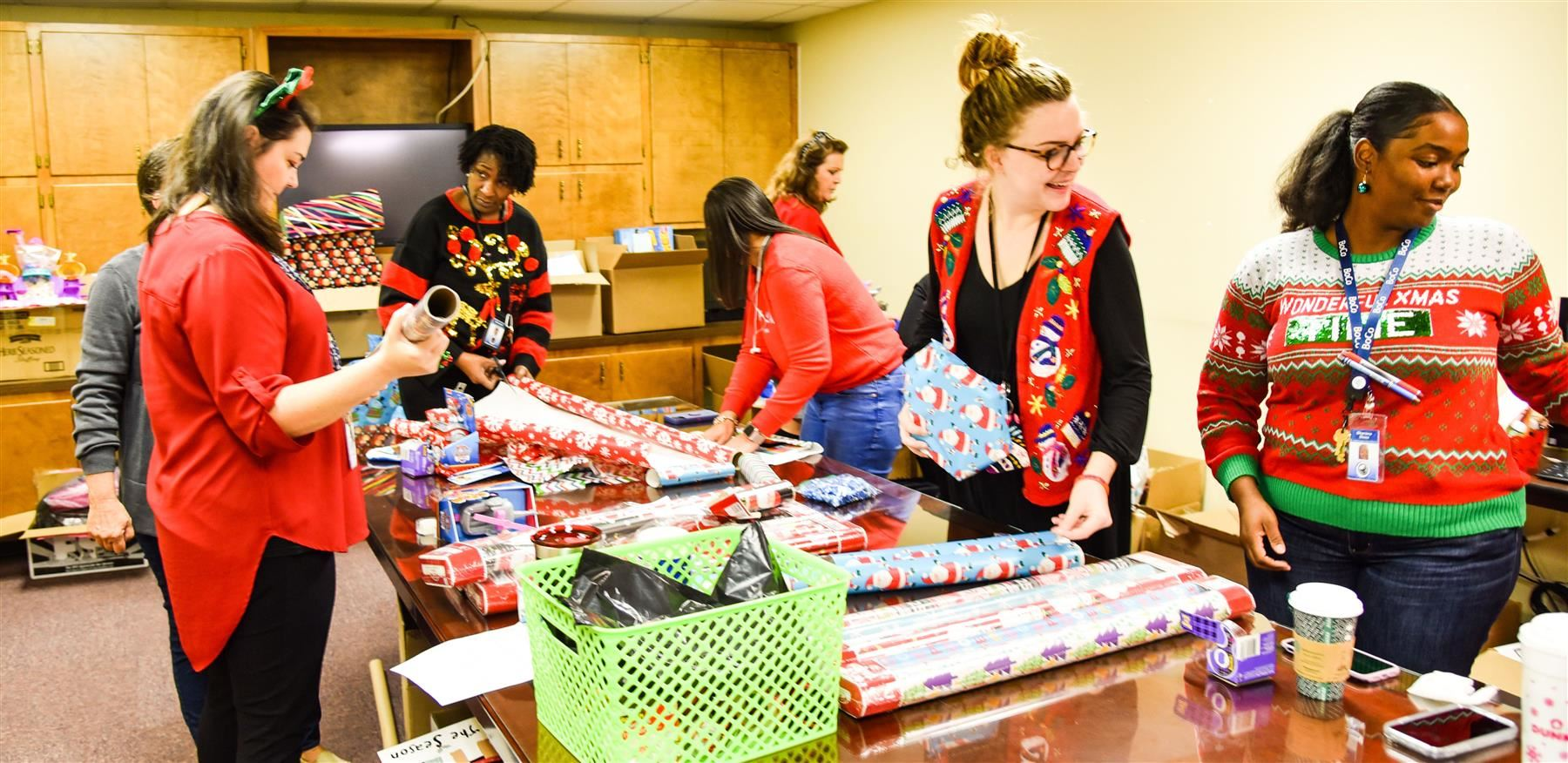 District social workers wrap presents for sponsored students
