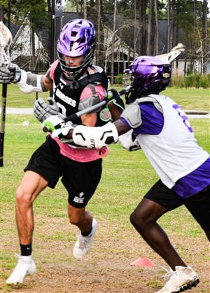 two boys in lacrosse scrimmage
