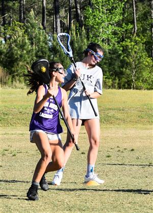 two girls during lacrosse practice