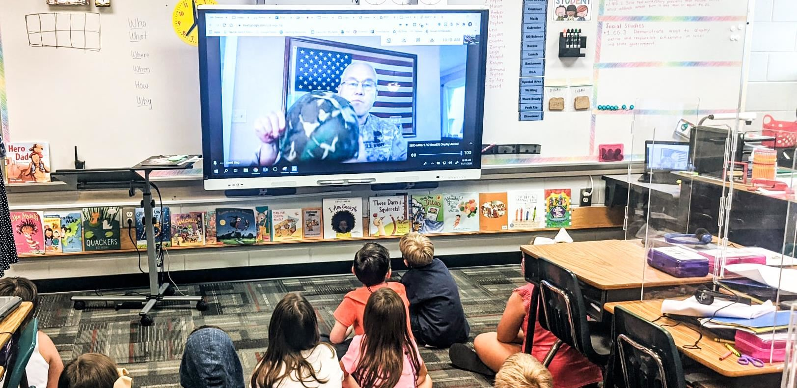 HBE students listen to a service member speaking on a Smartboard