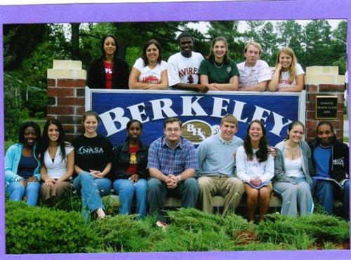 photo of renata cumbee with classmates around BHS school sign