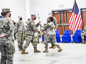 brittany lawrence gripping flag during change of command ceremony