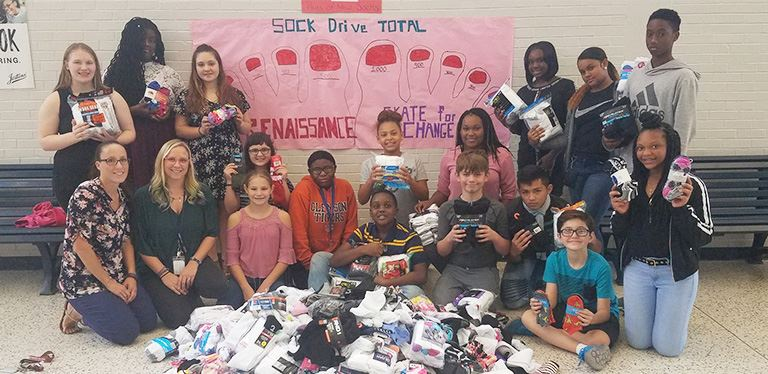 SFM Renaissance students with socks collected during Red Ribbon Week