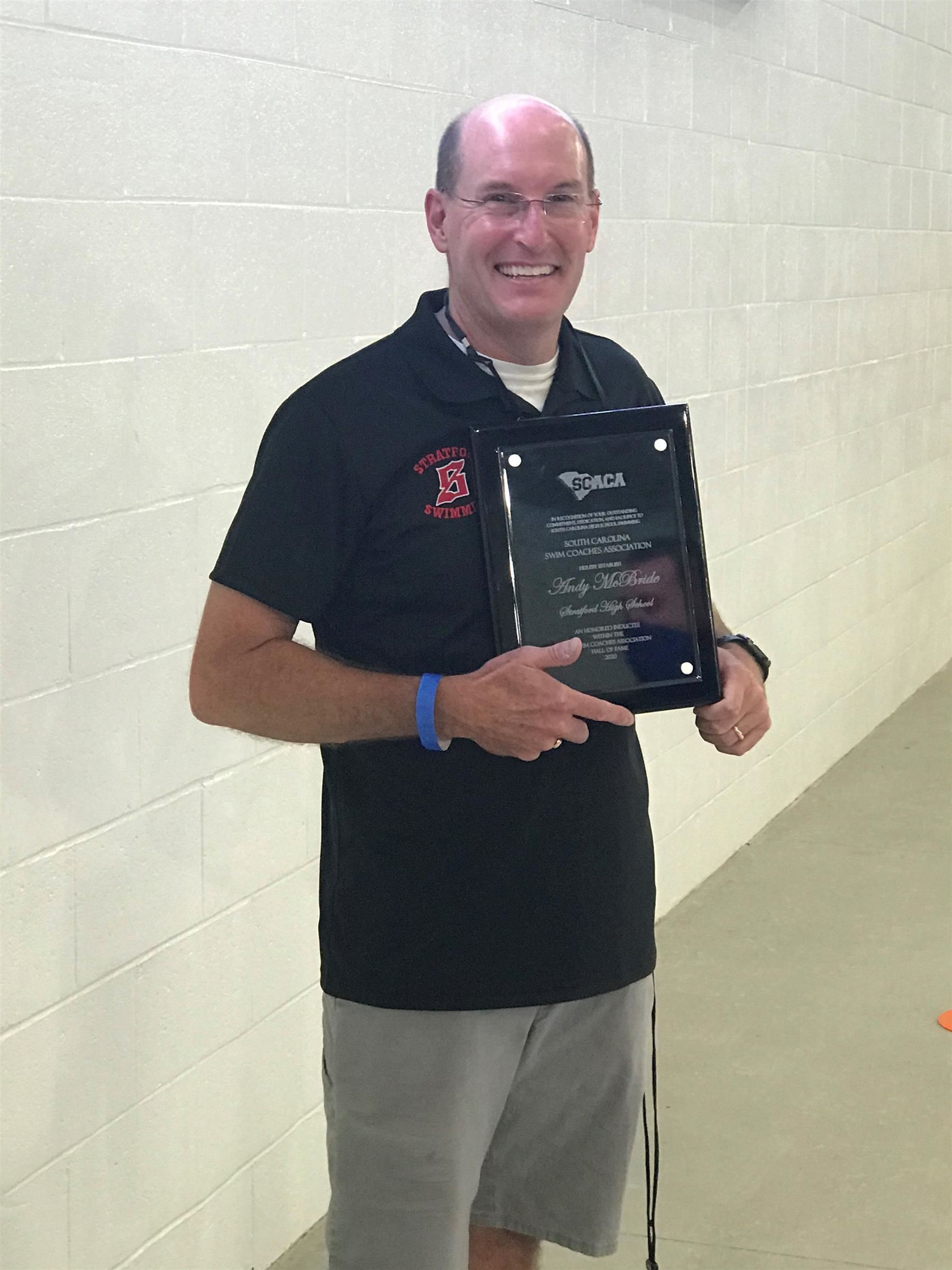 andy mcbride with award