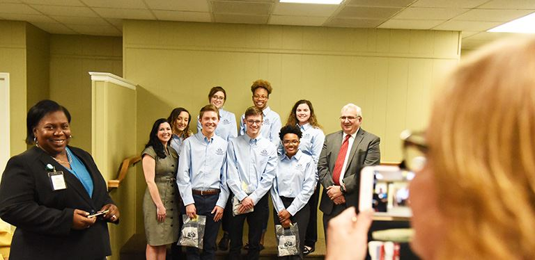 CTE student ambassadors pose for a photo at the second board meeting of February 2018