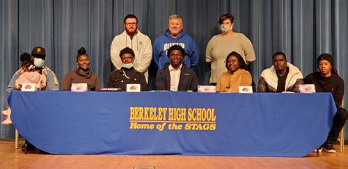 Butler with his family and coaches