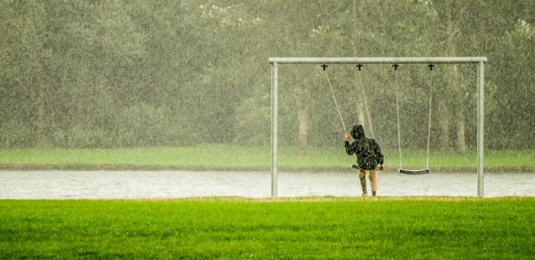 File photo of child on swing in rain