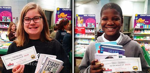 Conway Elementary students pose for photos with their book fair git certificates