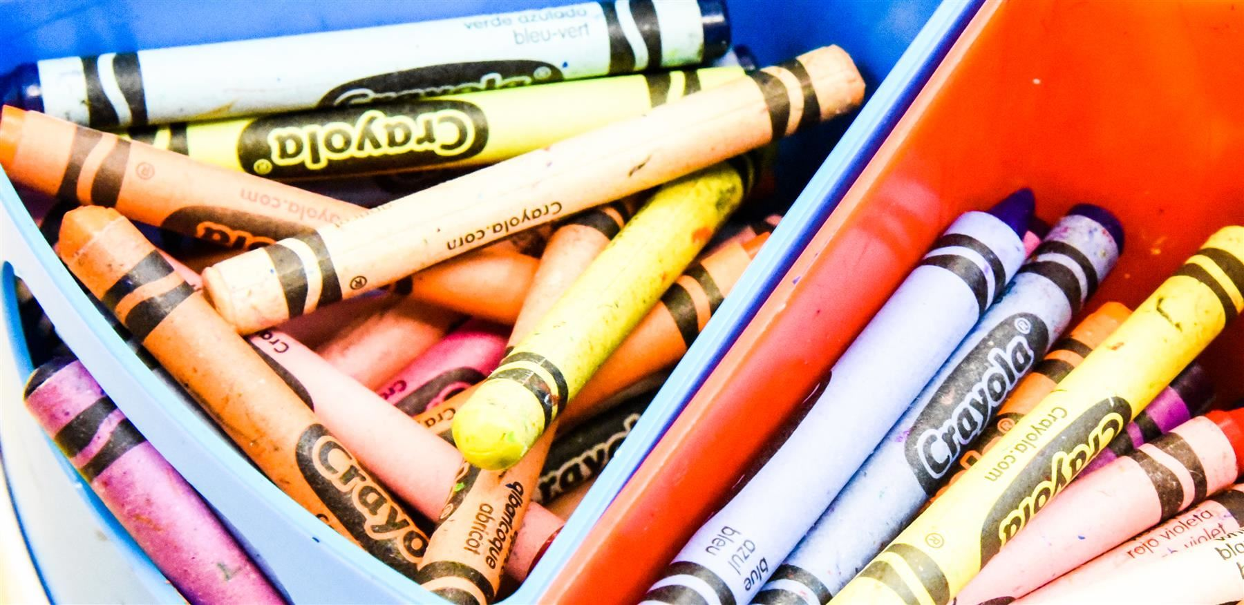 crayons in a bin