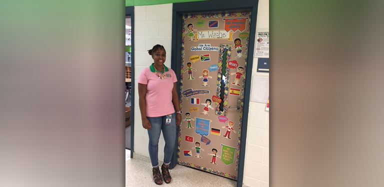 Mrs. Moshawnna Wyche stands outside her classroom door at Goose Creek Elementary