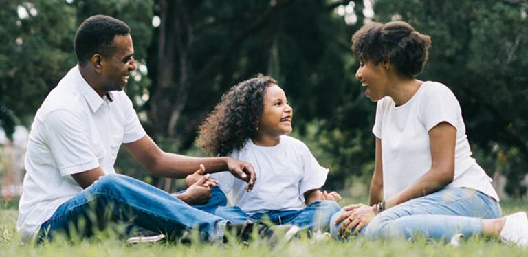 Generic Family Engagement image - Family laughing in grass