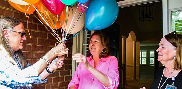 Judy Rainey surprised at home with balloons by BCSD admins
