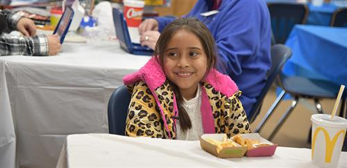 Student smiling during the monthly Lunch Buddy event
