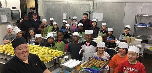 Photo of CNS team members on a kitchen tour with students