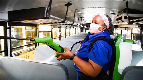 ruthie haskell sprays down the inside of a bus