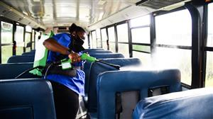 bus driver sprays down the inside of a bus