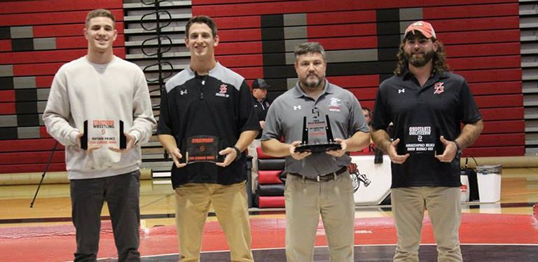 Photo of coaches and former wrestlers honored