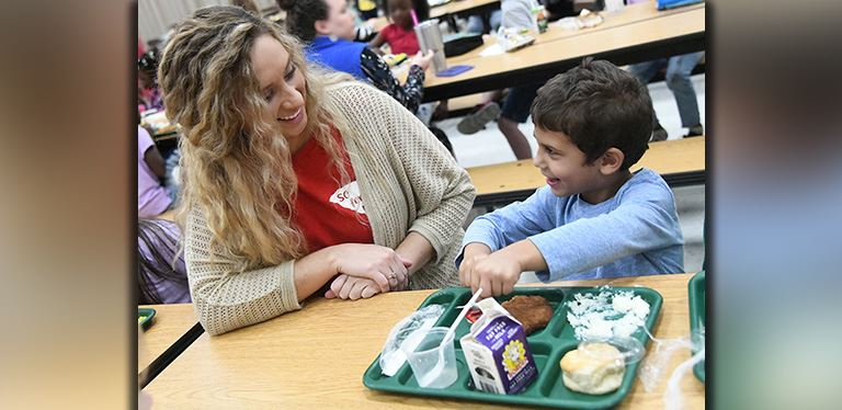 File photo of BCSD teacher at lunch with a student