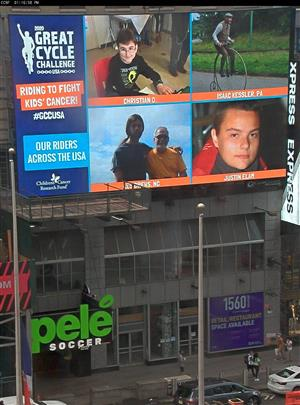photo of times square with christian's photo on display