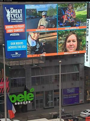 photo of times square with michelle howard's photo on display