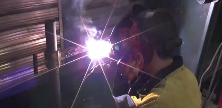 Image of student welding
