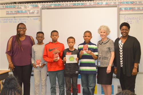 Photo of contest winners with teacher and principal