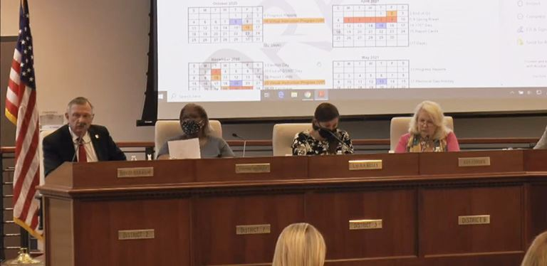 Photo of board members discussing instructional calendar